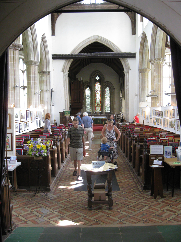 Visitors in nave looking at the exhibition