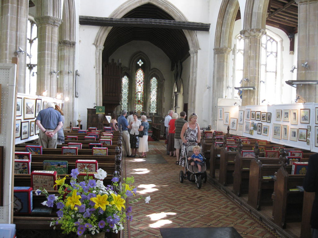 People looking at the pictures displayed in the nave